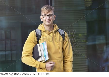 Happy Positive Academic Student Or Pupil, Young Guy In Glasses With Backpack And Books, Textbooks Lo