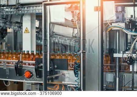 Beverage Factory, Conveyor Belt With Juice In Bottles, Industrial Interior, Food And Drink Productio