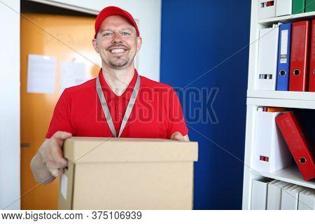 Portrait Of Smiling Handsome Deliverer. Courier Holding Big Box. Professional And Fast Delivery Pack