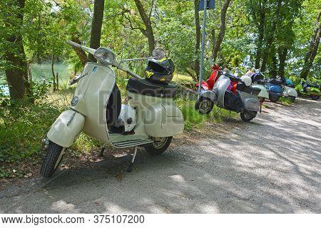 Villaggio Di Punta Sdobba, Italy - June 14 2020. Nine Vespas, Part Of A Small Rally Of Vespa Motorik