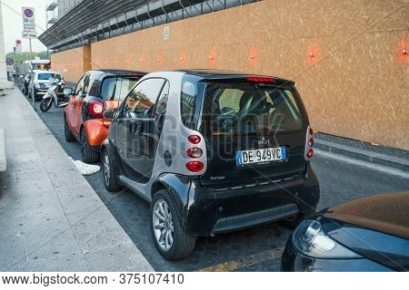 Rome, Italy - October 2019 : Many Perked Small Electric Cars In Rome Street.