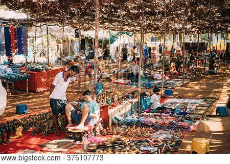 Anjuna, Goa, India - February 19, 2020: Man Seller Sells Indian Souvenirs In The Anjuna Market.