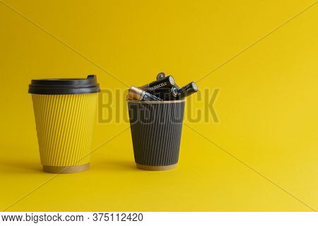 Kiev, Urkaine, 16 June 2020, Two Takeaway Paper Coffee Cups, Yellow With Coffee And Plastic Cover, B
