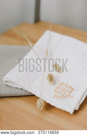 Pile Of Clean Linen Cotton Towels On The Kitchen Table. Pastel Colors. Food Photo Props. Natural Lin