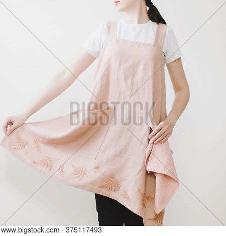 Maid Or Housewife In Linen Apron Isolated On White Background. Housekeeper Woman In Apron In The Kit