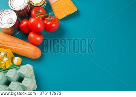 Top View On Food Donations On Green Background With Copyspace - Pasta, Fresh Vegatables, Canned Food