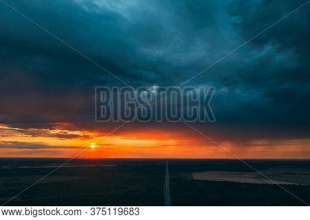 Aerial View Of Sunset Sky Above Highway Road Through Green Forest Landscape In Sunny Evening. Top Vi