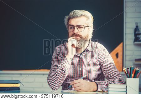 Bearded School College Teacher Man During A Math Class.