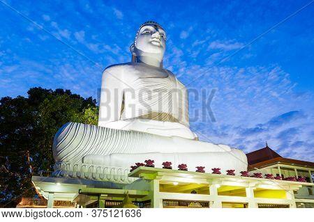 Bahirawa Kanda Or Bahirawakanda Vihara Buddha Statue In Kandy, Sri Lanka At Sunset. Bahirawakanda Is