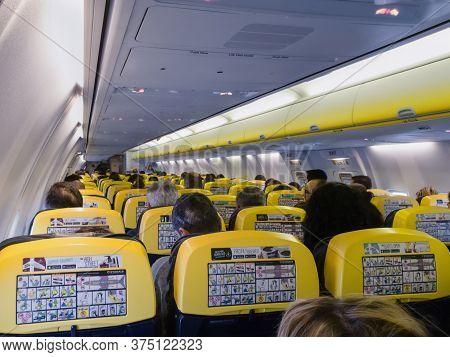 Budapest, Hungary December 10 2019: Passengers Inside A Ryanair Aircraft Cabin, During Flight. Inter