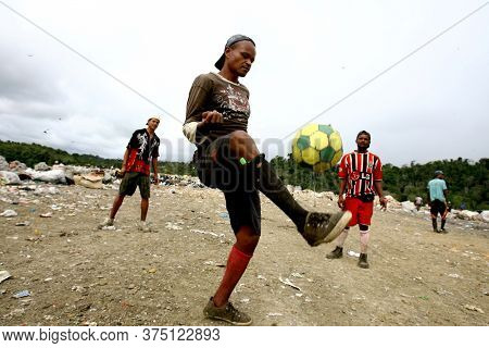 Itabuna, Bahia / Brazil - September 22, 2011: Waste Pickers Are Seen Playing Football At The Landfil