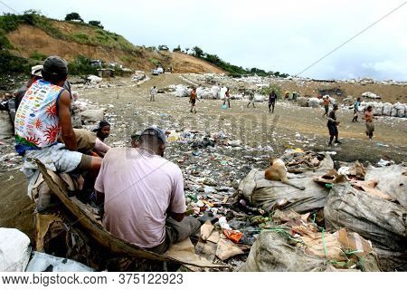 Itabuna, Bahia / Brazil - September 22, 2011: Waste Pickers Watch Their Colleagues Playing Football