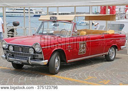 Capri, Italy - June 26, 2014: Cabrio Taxi Oldtimer Car At Island Capri, Italy.