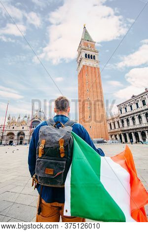 Man With Italian Flag At Saint Marco Square