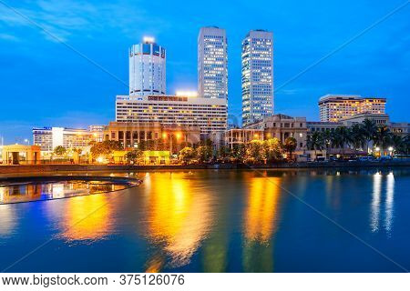 Colombo City Skyline And Beira Lake Chanel At Sunset. Colombo Is The Commercial Capital And Largest