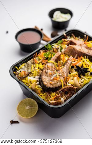 Online Food Delivery - Fish Pulao Or Biryani Packed In Plastic Box