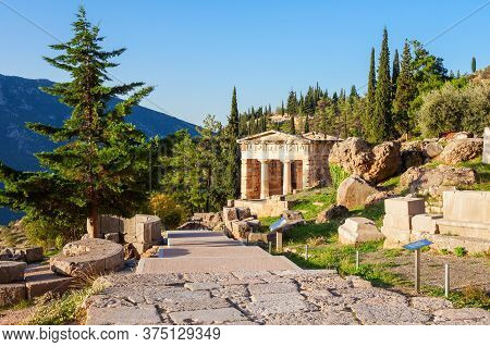 The Treasury Of Athens Or Athenian Treasure In Delphi. Delphi Is Ancient Sanctuary That Grew Rich As