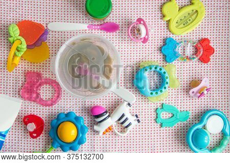 Baby Accessories On Pink Pattern Background On Table. Spoon And Bowl With Bear Image With Natural Ve