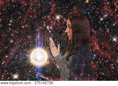 Girl On The Background Of The Starry Sky. Magic Ball. Paranormal Abilities, Clairvoyance. Elements O