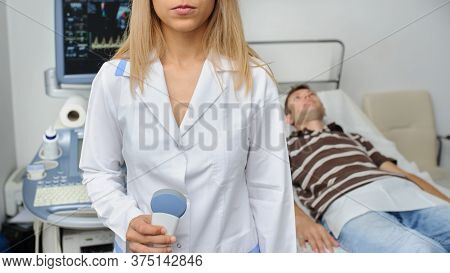The Doctor Using The Ultrasonography Device, Close View