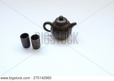 A Ceramic Kettle With Cups, Close View, White Background