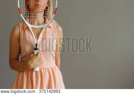 A Pretty Blonde Girl With Tennis Palette, Close View, Grey Background