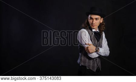 The Handsome Caucasian Young Man In A White Shirt, Suit And Hat Standing, Black Background