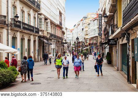 A Coruna, Spain - September 24, 2017: Tourists At The Pedestrian Street In The Centre Of A Coruna In