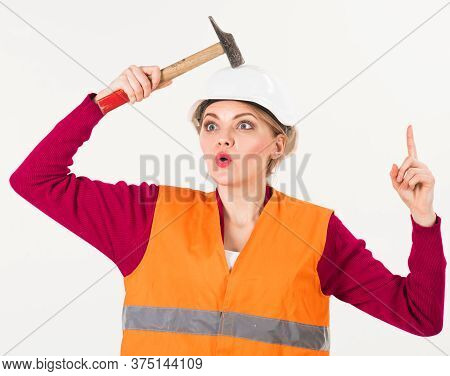 Woman With Surprised Face Knocks With Hammer On Head