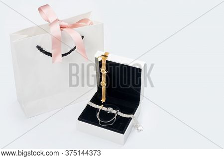 Silver And Gold Bracelets In Gift Box, Jewelry Flatlay On Neutral Background. Top View Of Fashion Lu