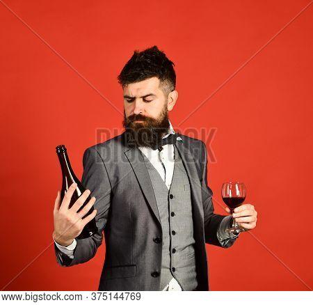 Winetasting And Degustation Concept. Man Holding Glass Of Cabernet