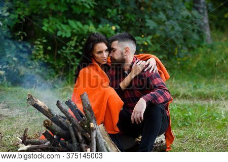 Young Couple With Calm Faces Have Rest After Hiking