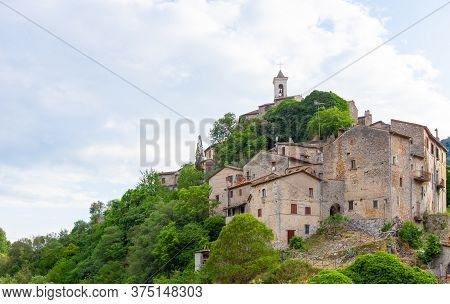 The Ancient Town Of Rocchette Seen From Below, Located In Italy, In The Province Of Rieti. Hdr Photo