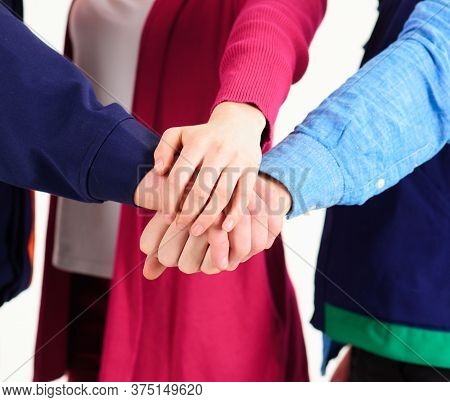 Teambuilding Concept. People Put Hands Together As Friendly Team.