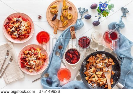 Kaiserschmarrn, Imperial Pancake, Traditional Dessert Of Austrian Cuisine. White Wooden Table With P