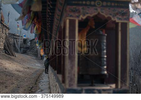 Buddhist Prayer Wheels And Flags, Upper Pisang, Trekking Annapurna Circuit, Himalaya, Nepal