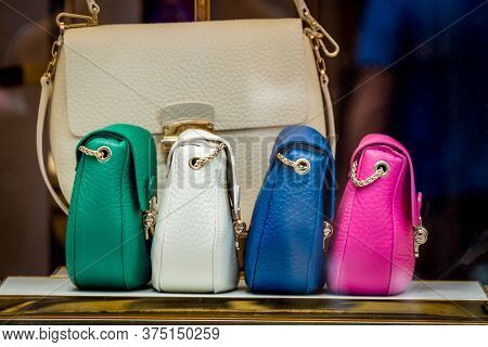 Featured Colorful Leather Womens Handbags In The Store. Shopping Concept. High Quality Photo