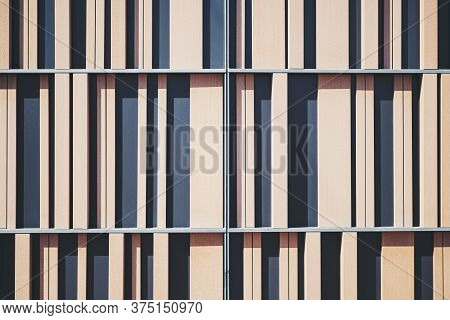 Frontal View Of An Abstract Wooden And Metal Contemporary Building Facade With Vertical Stripes Of T