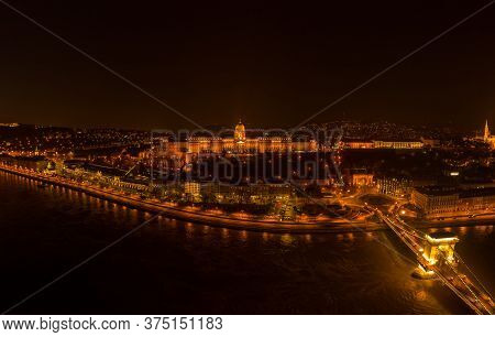 Aerial Drone Shot Of Buda Castle On Buda Hill In Budapest Night With City Lights On