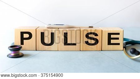 Pulse Word Written In The Wooden Cube. Medicine Concept