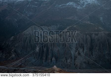 Buddhist Stupa With Prayer Flags In Front Of Massive Mountain, Trekking Annapurna Circuit, Himalaya,
