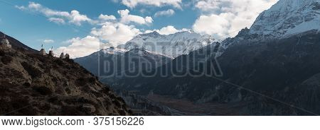 Panorama Of Buddhist Stone Monuments With Prayer Flags In The Nepalese Mountains, Trekking Annapurna