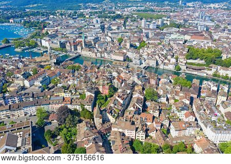 Aerial view of Limmat river and famous Zurich churches. Zurich is important financial center of Switzerland and lovely historical city.