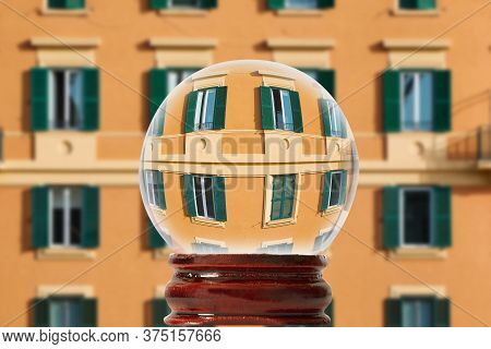 The Facade Of A Building With Windows On A Street Of Rome, Italy  Through A Glass Transparent Ball