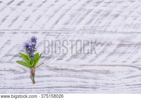 A Posy Of Lavender On Wooden Background