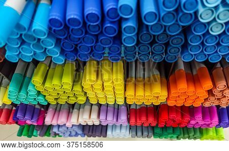 Colored Pens On Shelves In The Shop,office Supplies And Stationery. Colorful Pens Arranged On Shelve