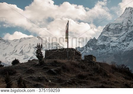 Buddhist Stone Building With Prayer Flags Over Manang Mountain Village, Trekking Annapurna Circuit,