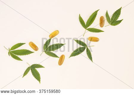 Hemp Extraction Oil In Capsules Near Cannabis Leaves Isolated On White