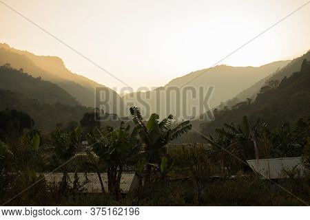 Bright Sunset Over A Valley In The Nepalese Mountains, Annapurna Circuit