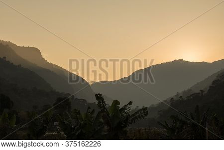 Bright Sunset Over A Valley In The Nepalese Mountains